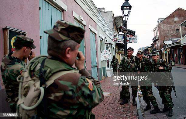 Staff Sgt Joe Kella of the Oregon National Guard takes a picture of other soldiers as they pose underneath a Bourbon Street sign September 12 2005 in...