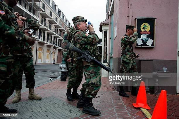 Staff Sgt Joe Kella of the Oregon National Guard takes a picture on Bourbon Street Bourbon Street sign September 12 2005 in New Orleans Louisiana...
