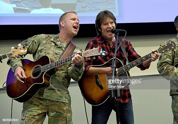 Staff Sgt John Brandon Boron a member of SixString Soldiers a fourmember ensemble of the US Army Field Band and recording artist John Fogerty perform...