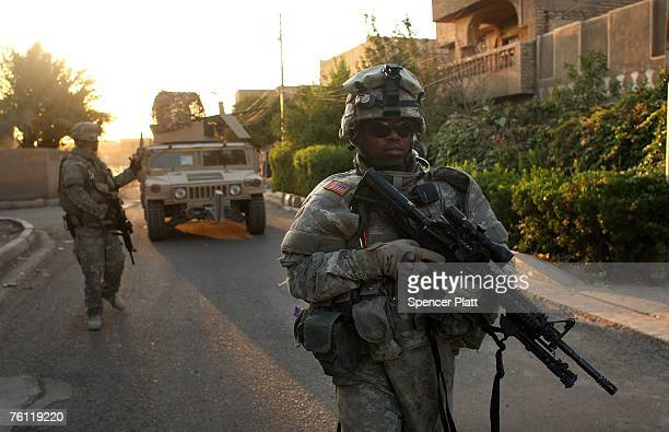 Staff Sgt Richard Howell of Brooklyn New York with the US Army Delta Company 212 Cavalry patrols in the Ghazliya neighborhood which has been used as...