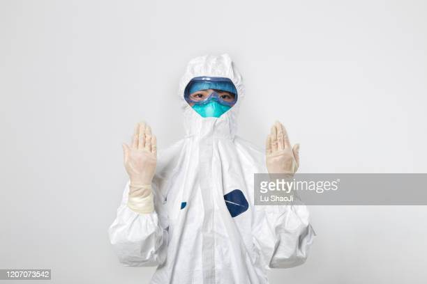 cdc staff standing in front of the white background wall. - hazmat stock pictures, royalty-free photos & images