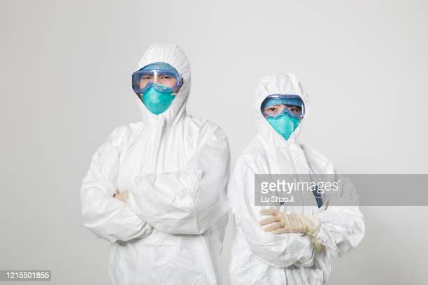 cdc staff standing in front of the white background wall. - protective workwear stock pictures, royalty-free photos & images