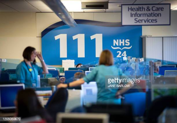 NHS staff supporting Scotland's public information response to the new coronavirus COVID19 are pictured as they work at the NHS 24 contact centre at...