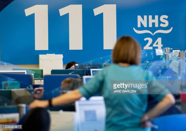 Staff supporting Scotland's public information response to the new coronavirus, COVID-19, are pictured as they work at the NHS 24 contact centre at...