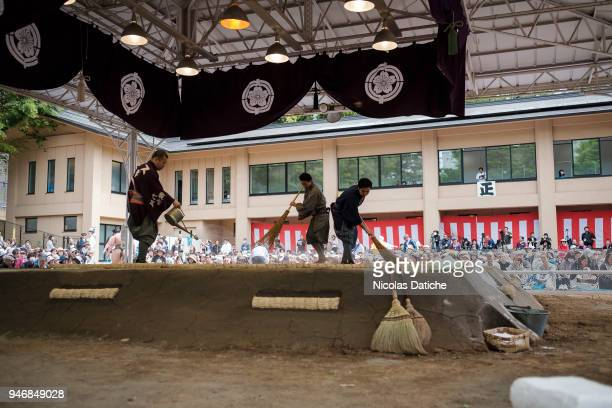 Staff sweep the Dohyo during 'Honozumo' ceremonial on April 16, 2018 in Tokyo, Japan. This annual offering of a Sumo Tournament to the divine at the...