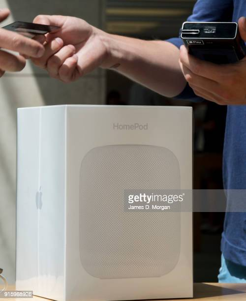 Staff take credit cards as customers purchase at the launch of the HomePod at the Apple Store on February 9 2018 in Sydney Australia Apple's latest...