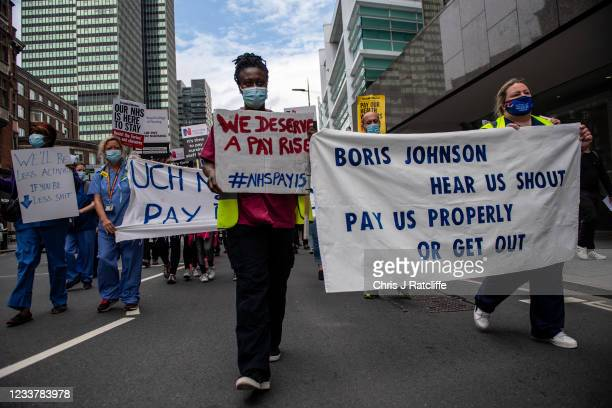 Staff take part in a march through central London demanding a pay rise on the 73rd birthday of its founding on July 3, 2021 in London, England....
