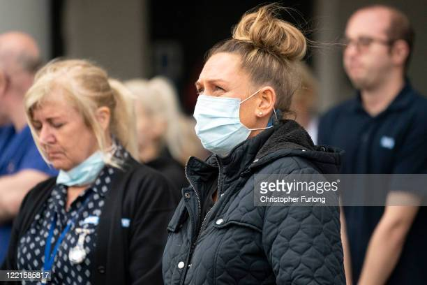 NHS staff take part in a minute's silence outside Salford Royal Hospital on April 28 2020 in Salford United Kingdom The moment of silence...