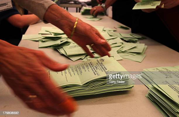 AEC staff tally ballot papers at Tuggerah Public School in the electorate of Dobell on election day on September 7 2013 in Gosford Australia Voters...