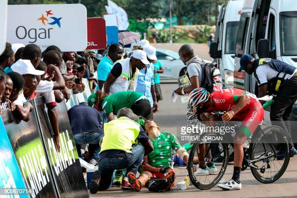 TOPSHOT Staff tend to a cyclist injured during an accident at the arrival of the second stage of the 2018 edition of La Tropicale in Fougamou on...