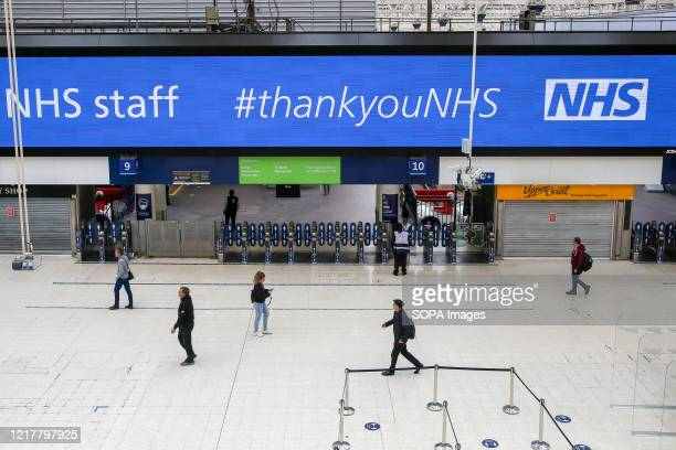 NHS staff #thankyouNHS is displayed on a Coronavirus public information campaign poster at London Waterloo Station