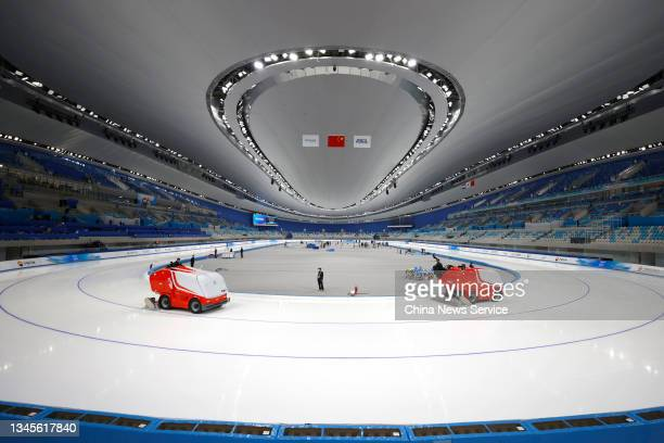 Staff tidy the track before a match on day one of the Speed Skating China Open, a test event of the 2022 Beijing Winter Olympic Games, at the...