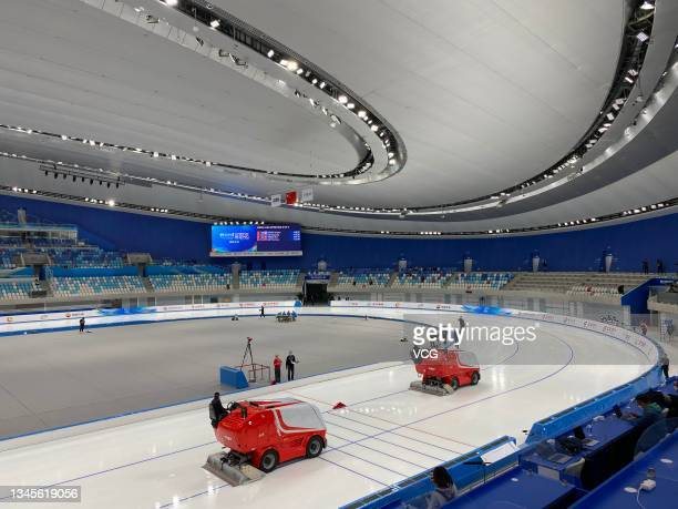 Staff tidy the track on day one of the Speed Skating China Open, a test event of the 2022 Beijing Winter Olympic Games, at the National Speed Skating...