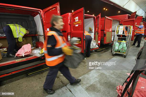 Staff unload vans at Royal Mail's sorting office in Filton one of the biggest in the UK as they help process an expected 2000 letters parcels and...