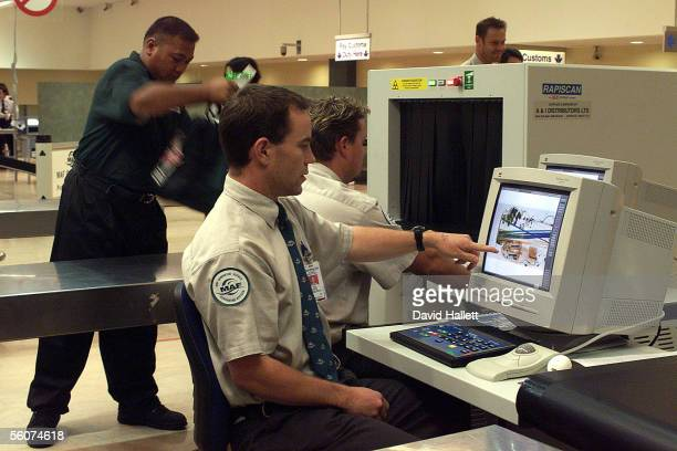 MAF staff use their new xray machine at Auckland International Airport to check the luggage of incoming passengers
