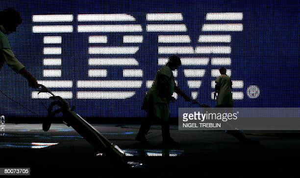 Staff use vacuum-cleaners to clean the floor at the IBM stand at the CEBIT trade fair on March 1, 2008. The world's biggest high-tech fair will be...
