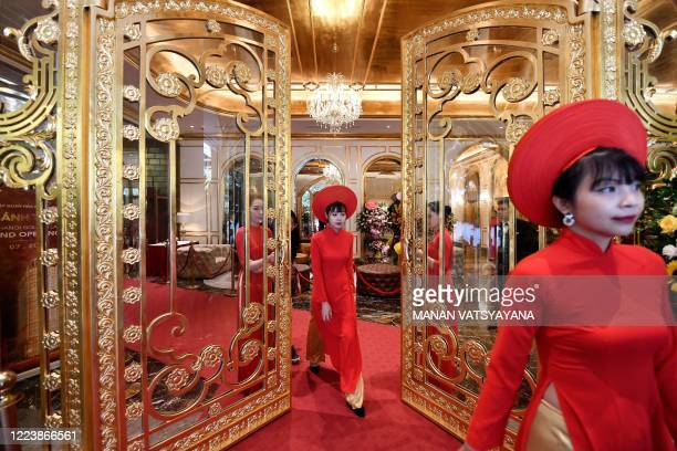 Staff wait to welcome guests in the lobby of the newly-inaugurated Dolce Hanoi Golden Lake hotel, the world's first gold-plated hotel, in Hanoi on...