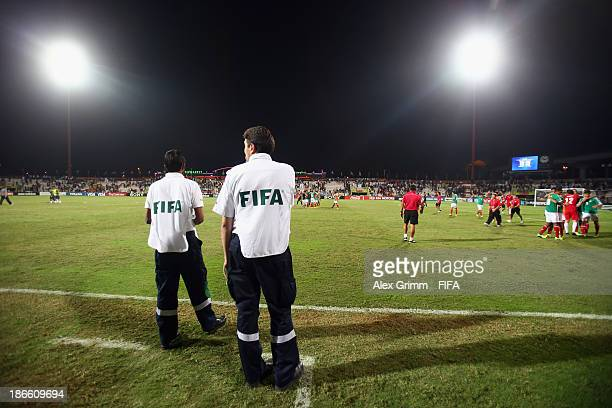 FIFA staff waits to escort players to the doping controle after the FIFA U17 World Cup UAE 2013 Quarter Final match between Brazil and Mexico at Al...