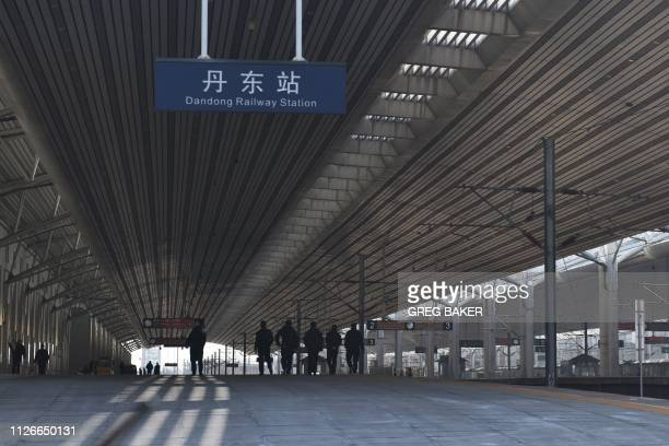 Staff walk on a platform at Dandong Railway Station in the Chinese border city of Dandong in China's northeast Liaoning province on February 22 2019...