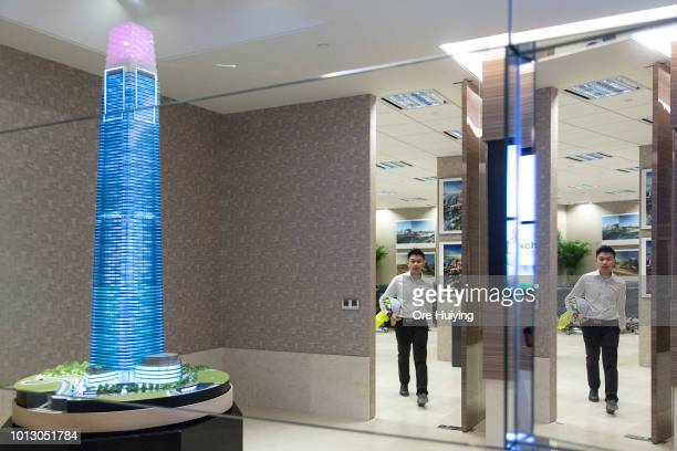 A staff walks past the Tun Razak Exchange Tower model at the project office on July 30 2018 in Kuala Lumpur Malaysia The Tun Razak Exchange one of...