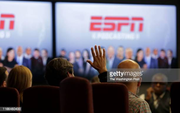 Staff watches a presentation with Vice President of ESPN Norby Williamson, who also oversees SportsCenter, during a meeting in the executive...