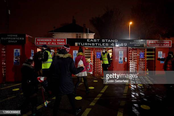 Staff wearing face masks greet fans outside the stadium ahead of the Sky Bet League One match between Charlton Athletic and Milton Keynes Dons at The...
