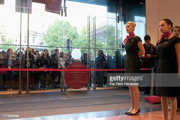 Staff welcome shoppers at Galeries Lafayette on June 26 2013 in Paris France