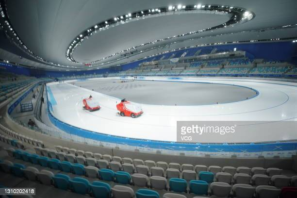 Staff work at National Speed Skating Oval, built for the 2022 Beijing Winter Olympics, on March 31, 2021 in Beijing, China.