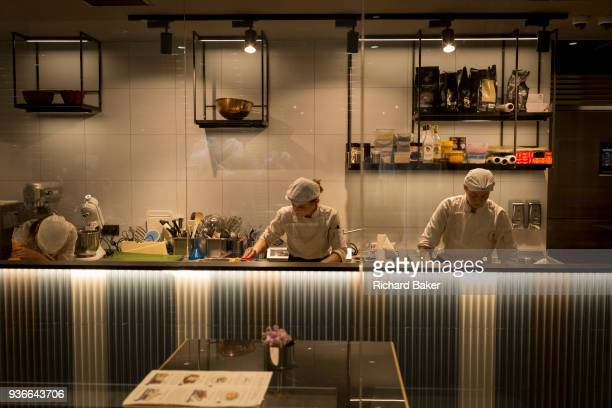Staff work behind the counter of a smart cafe in the centre of the Czech cacapital on 19th March in Prague the Czech Republic