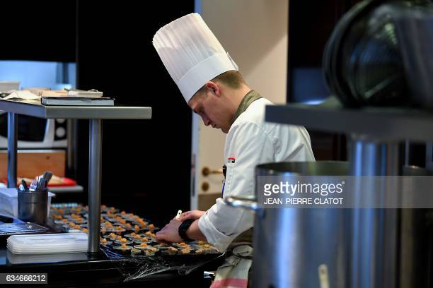 Staff work in the kitchen of the threestar restaurant 'Le 1947' run by French chef Yannick Alleno at the fivestar palace hotel 'Le Cheval Blanc' in...