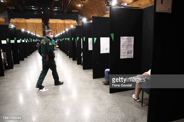 Staff work to vaccinate and check people at Vodafone Events Centre on August 01, 2021 in Auckland, New Zealand. New Zealand's first mass Covid-19...