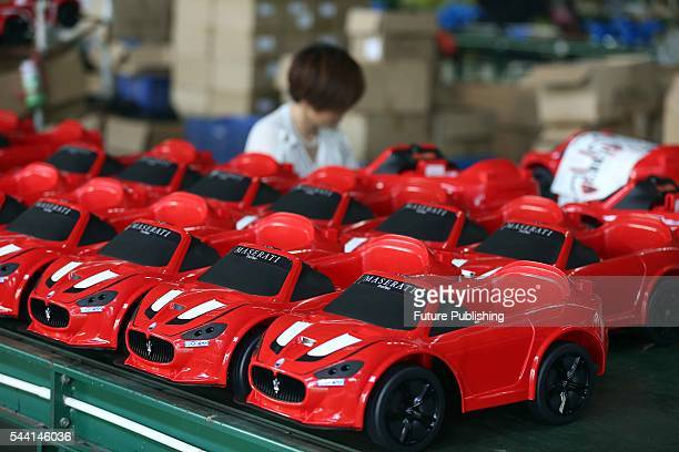Staff work with toy cars in a toy factory on July 01 2016 in Jinjiang China Feature China / Barcroft Images LondonT44 207 033 1031...