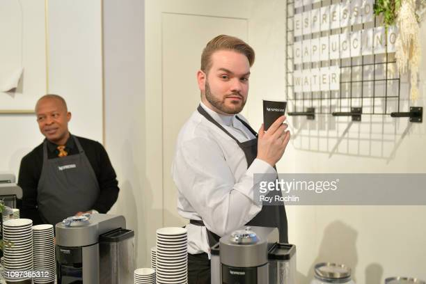 A staff worker poses with refreshments provided by Nespresso in The Lobby of Spring Studios during New York Fashion Week The Shows at Spring Studios...