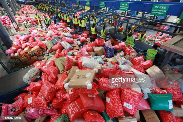 Staff workers sort packages at a mail processing center during Double 11 shopping festival on November 11 in Yangzhou Jiangsu Province of China