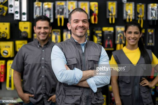 Staff working at a hardware store selling tools