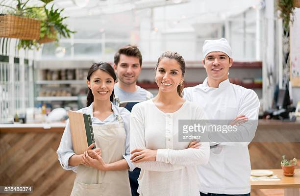 staff working at a restaurant - colletti bianchi foto e immagini stock