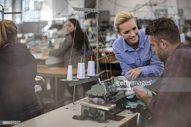 staff working in textile factory - fábrica têxtil imagens e fotografias de stock