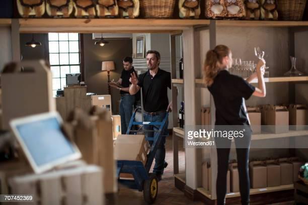 Staff working in wine shop