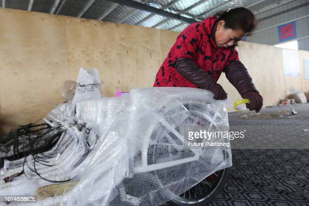 Staff works at a factory making electric cargo bikes and vending bikes in Huaibei in central China's Anhui province Friday, Dec. 21, 2018. The orders...