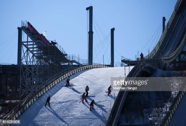 Staff works on the normal hill during previews ahead of the PyeongChang 2018 Winter Olympic Games at Alpensia Ski Jumping Centre on February 4 2018...