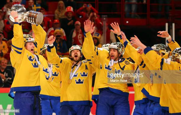 Staffan Kronwall of Sweden lifts the trophy after winning the IIHF World Championship final match between Swiss and Sweden at Globen Arena on May 19,...
