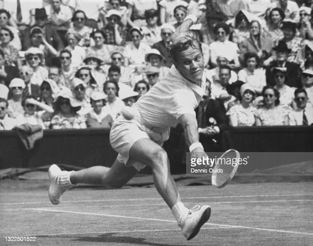 Staffan Stockenberg of Sweden reaches to make a backhand return against Gardnar Mulloy of the United States during their Men's Singles Third Round...
