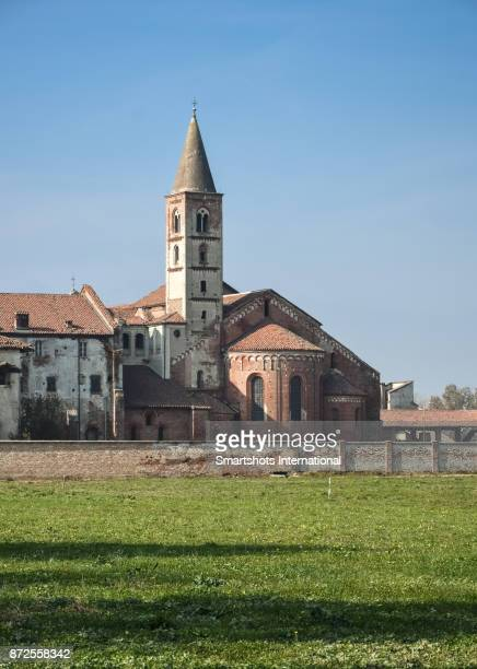 staffarda abbey's apse and bell tower, an example of medieval cistercian architecture in piedmont, italy - apse stock photos and pictures