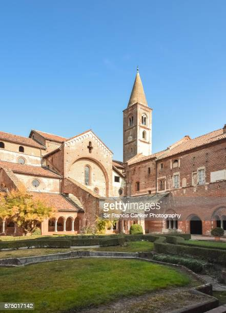 Staffarda abbey's cloister and bell tower, an example of medieval Cistercian architecture in Piedmont, Italy