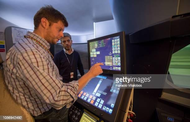A staffer checks the instructor's computer in TAP A320 medium range flight simulator in TAP Air Portugal training center in Lisbon International...