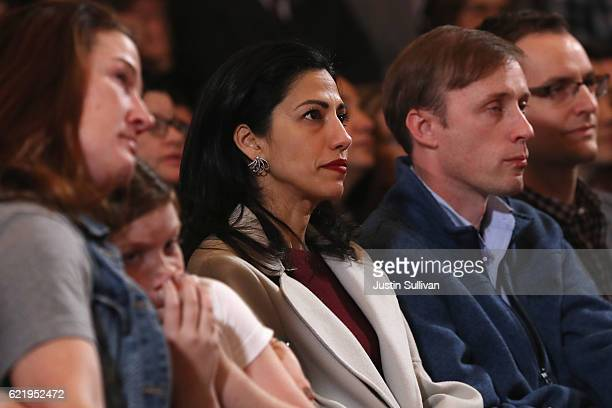 Staffer Huma Abedin listens as former Secretary of State Hillary Clinton concedes the presidential election at the New Yorker Hotel on November 9,...