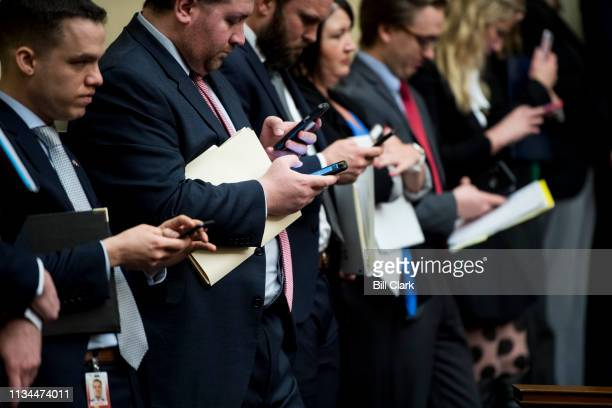 Staffer line the aisle during the House Oversight and Reform Committee markup of a resolution authorizing issuance of subpoenas related to security...