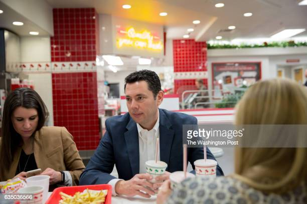 Staffer MJ Henshaw and Rep Jason Chaffetz eat with staff at InNOut Burger after a town hall in Cottonwood Heights UT United States on February 9 2017