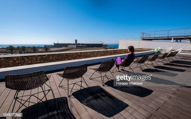 A staffer sits on the alumni terrace at NOVA School of Business and Economics new campus on October 04 2018 in Carcavelos Portugal Nova SBE is a...