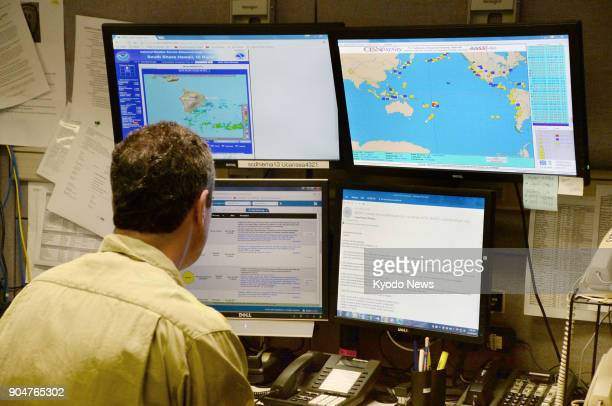 A staffer watches for disaster alerts in the Hawaii Emergency Management Agency command center in Honolulu United States on Nov 30 2017 ==Kyodo